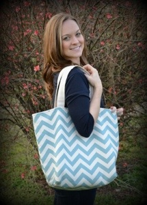 Kristen Hardin, founder of Kristen Grace Designs posing with one of her Fwisty totes!